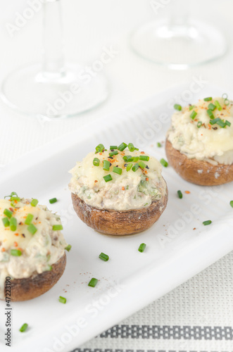 Stuffed mushrooms, baked with cheese and herbs, selective focus