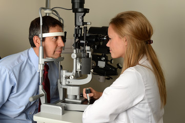 Young Eye Doctor with her patient