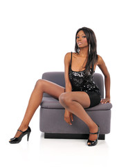Young Black American Woman sitting on a couch