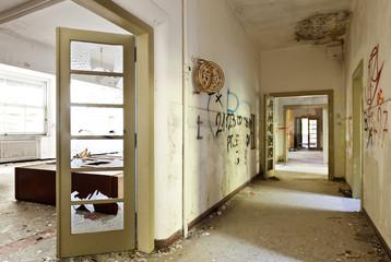 abandoned building, long corridor with broken doors