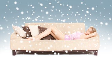 sleeping woman on sofa with snow
