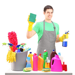 A smiling male cleaner with cleaning equipment