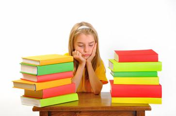 Education - Girl sulking among some books, isolated on white