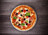 Fototapety Delicious italian pizza served on wooden table