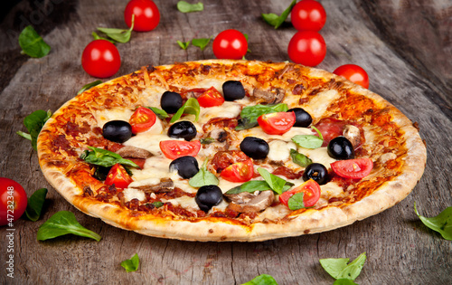 Delicious italian pizza served on wooden table - 47232348