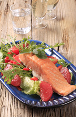 Seared salmon with salad greens and red orange