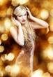 Sexy blond woman on golden background