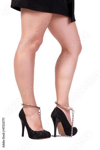 Woman in leg irons