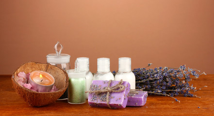 ingredients for soap making on brown background