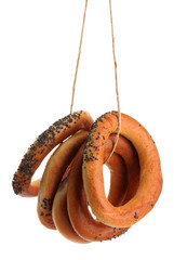 tasty bagels on rope, isolated on white