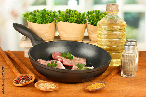 composition of raw meat and spices on wooden table close-up