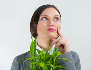 Adult business woman holding lucky bamboo plant symbol of succes