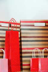 Assorted shopping and gift red paper bags - shopping and holiday
