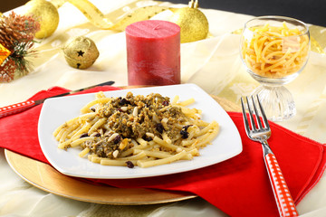 Pasta with sardines and fennel on Christmas table