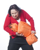 woman carrying too much luggage with humour poster
