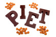 "The word ""PIET"" in chocolate letters and pepernoten isolated on"