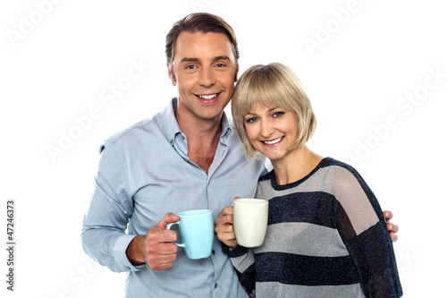 Couple starting their day with a cup of coffee