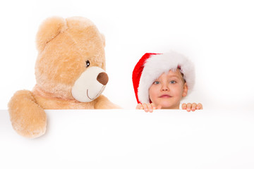 kind und teddybär mit plakat
