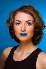Fashion portrait of woman with fashion makeup - blue lips, blue