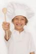 Kleiner Junge mit Kochlöffel
