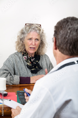 Worried Woman Talking with Her Doctor