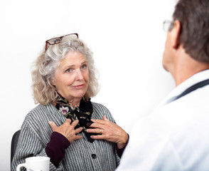 Mature Woman Talking Frankly with Her Doctor