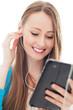 Female teenager using digital tablet