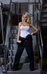 A sexy blonde woman wearing overalls.