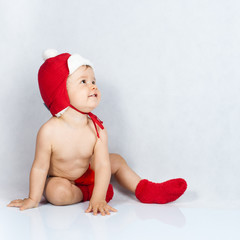 Portrait of baby wearing red cap and underwear
