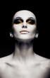Bald futuristic woman - clean shaven head. Fashion design