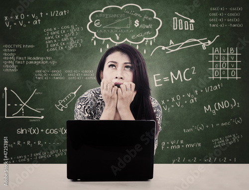 Girl with laptop is nervous facing exam
