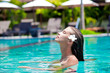 half face portrait of beautiful woman in luxury pool