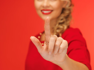 woman in red dress pressing virtual button