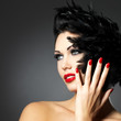 Woman with red nails and creative hairstyle