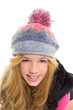 Kid girl with winter wool cap smiling on white