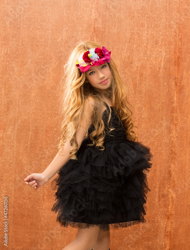black dress kid girl dancing on vintage background