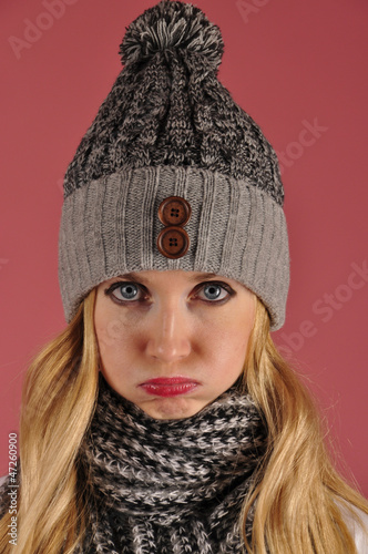 glad girl in warm hat