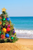 Fototapety Christmas tree on the sand in the beach