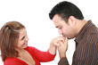 Husband kissing hand of smiling wife