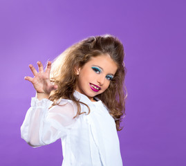 Children fashion scaring makeup kid girl on purple