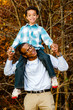 Fall or winter portrait of African-American father and son