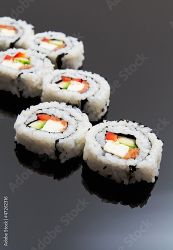 Sushi set on black reflection background