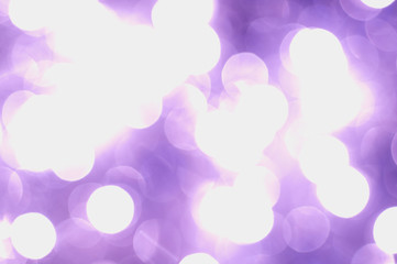 Abstract glowing lights on a violet background