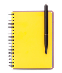 Yellow cover notebook with black pen