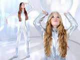 Futuristic children girl and astronaut woman