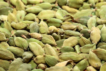 Green cardamom seeds. Aromatic spice.texture background