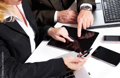 Business people group working with laptop.