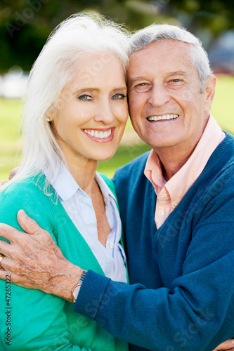 Outdoor Portrait Of Happy Senior Couple