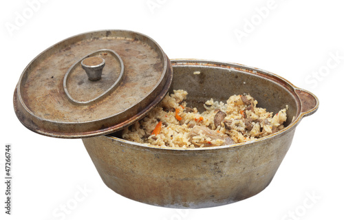 pilaf in cauldron on white background