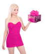 blond girl in pink dress holding Christmas gift box isolated